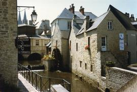 Photograph of a watermill on a town river, France