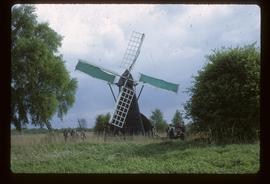 Norman's Mill, Wicken Fen, at work while visitors look on