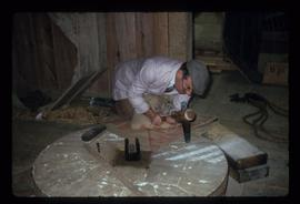 Man dressing bedstone, Batemans Mill, Burwash