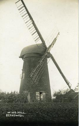Postcard of derelict mill with cap and part of sails