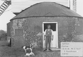 Mr E Self, miller in Parham, Suffolk, standing in front of the roundhouse