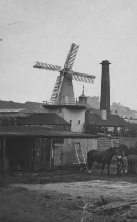Buckland Brewery Mill, Dover, with wooden buildings to the fro
