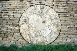 Photograph of a millstone in a wall, Slaughter Farm, Bourton on the Water, Gloucestershire