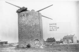 Ruined East Mill in Easton, Portland, Dorset, with a building to the right