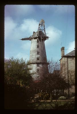 Tower mill, Sutton, derelict, with cap, fantail and fragments of two sails