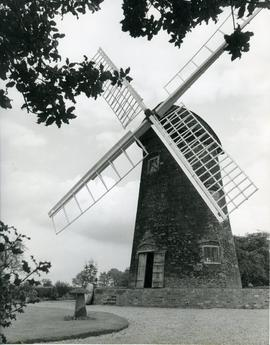 View of the restored mill with staddle stone and millstone