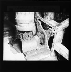Interior of drainage mill showing axle and boss of pit wheel and footing of upright shaft