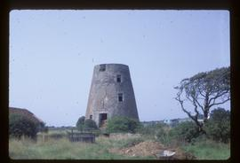 Derelict capless tower of tower mill, in use as hay store