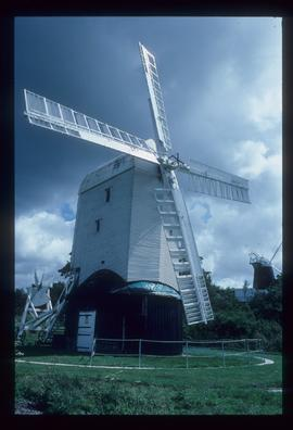 Restored post mill in working order and restored tower mill with sails