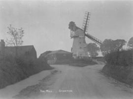 View from lane showing mill workman up a ladder, Bury Road Mill, Stanton