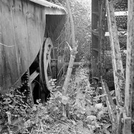 Waterwheel and a drive powering machinery in an adjacent shed, Roke Farm Wheel, Bere Regis