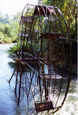 Photograph of a waterwheel, River Puig, Thailand
