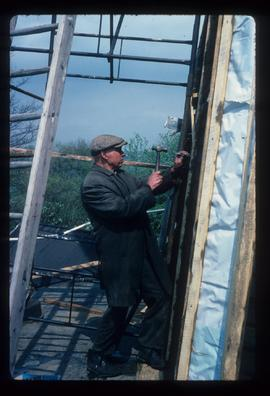 Archie Dallaway working on repairs to fabric, Cherry Clack Mill, Punnett's Town