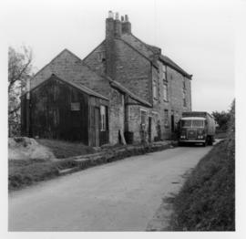 Low Mill Pickering, outside view with a truck