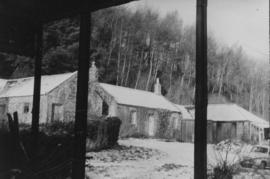 View of snow-covered outbuildings