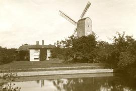 View of mill and house across river