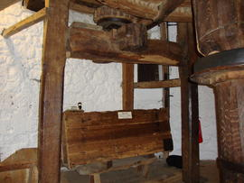 View of spout floor showing upright shaft, stone nut and tentering gear supports, Knowle Mill, Be...