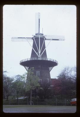 Tall preserved tower mill with sails and stage