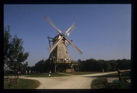 Restored smock mill with sails in open-air museum