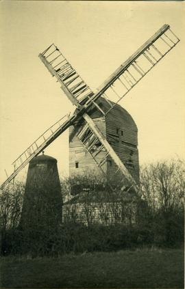 showing post mill with tower mill without cap and sails on left