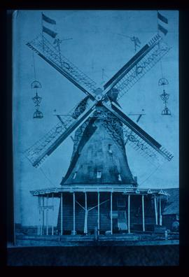 Smock mill in working order, with sails decorated with flags