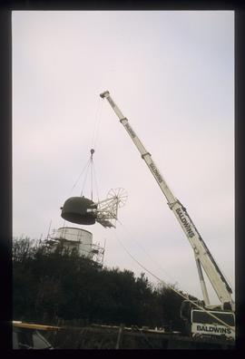 Cap and fan being fitted by crane, Waterhall Mill, Patcham