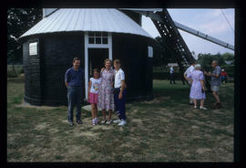 Group photo of family with roundhouse in background