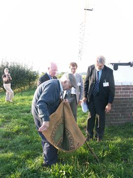 KCC officials and Mr Nelson Doody with sack, post mill, Chillenden