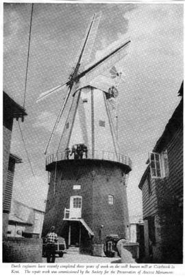 View from yard showing millwrights on reefing stage, Union Mill, Cranbrook