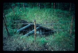 Hole in ground with pair of pipes - Baltic region