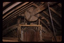 View of bin floor showing brakewheel and sack hoist, New Mill, Cross in Hand