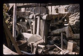 Hammer mill with building collapsed around it