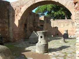 Animal-driven millstones in a bakery at Ostia near Rome
