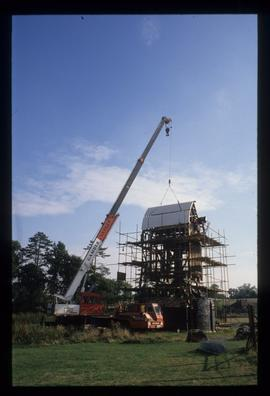 Roof being lifted by crane, Lowfield Heath Mill, Charlwood