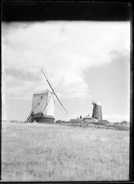 Preserved post mill with sails and preserved tower mill without