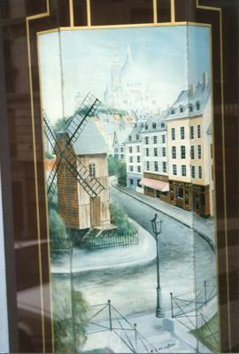 Photograph of a shop front corner depicting a windmill, Montmartre, France
