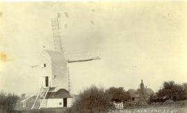 Post mill, Brenzett, with buildings