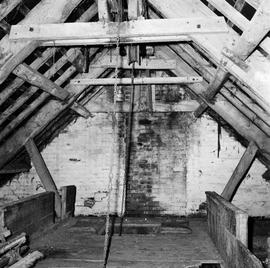 Interior of the attic floor showing two sack hoists, Lower Burton Mill, Charminster, Dorchester