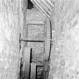 Interior showing two cogged wheels within a narrow pit, Blashenwell Farm Wheel, Corfe Castle