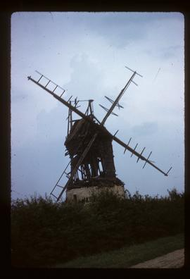 Post mill, Lower Dean, derelict, with four sails and remains of roof fantail
