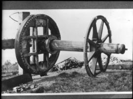 Windshaft, break and tail wheels sitting on the ground, Glyndebourne Mill, Ringmer