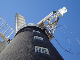Looking up from ground at cap, sails, fantail and striking gear, Dobson's Mill, Burgh le Marsh