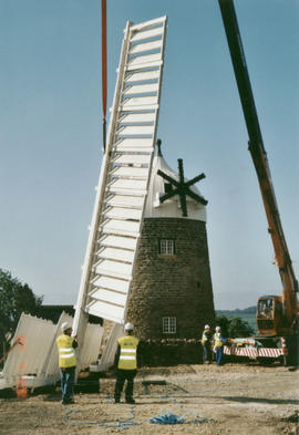 The first sail is lifted in place at Heage Tower Mill