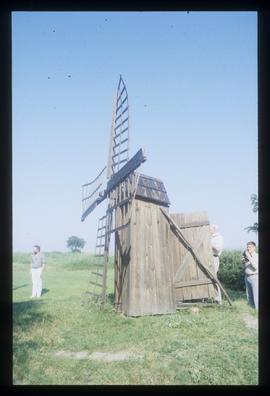 Odd-looking, very small post(?) Mill - looks like a cupboard with sails!