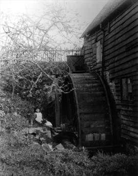 Detail view of waterwheel with posed girl, Whitley Mill, Chevening