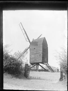 Post mill, Nutley, derelict, with stocks and at least three sails (one damaged)