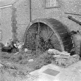 Waterwheel against a corner of wall, surrounded by junk, Lackington Mill, Piddletrenthide