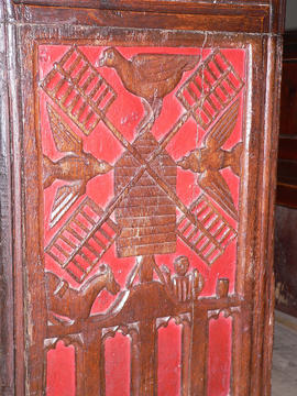 Carving of a post mill on an early 16th century church bench end at Bishop's Lydeard, Somerset