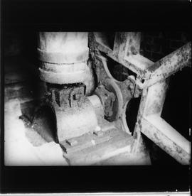 Interior of watermill showing boss and axle of waterwheel and footing of upright shaft
