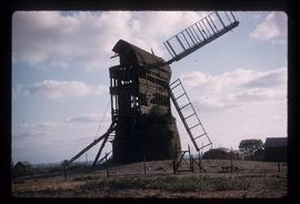 Post mill, Wrawby, derelict, with two sails visible